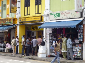 Largely Tamil migrant men queuing up to remit their salaries back home.