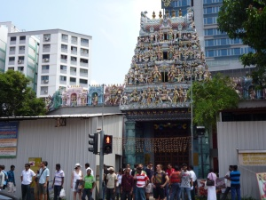 Criss-crossing path of migrant workers and tourists in Little India's temple.