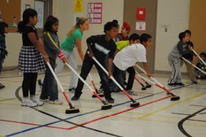 Children learning Curling (Courtesy of the Canadian Curling Association)