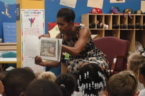 First Lady Michelle Obama reads to a classroom. Credit: US Navy, Flickr Commons