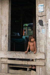A child of the Embera people, displaced by armed conflict, in Rio Suchio, Colombia. Rio Suchio, Colombia. UN Photo/Mark Garten.