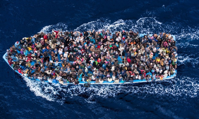A boatload of refugees rescued 20 miles north of Libya by the Italian Navy during Operation Mare Nostrum in 2014. Massimo Sestini's stunning photograph took second prize in this year's World Press Photo competition.