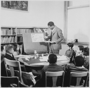 Jacob Lawrence with students at the Abraham Lincoln School.
