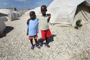 Children stand inside a new camp site in Croix des Bouquets, Haiti. UN Photo/Sophia Paris.