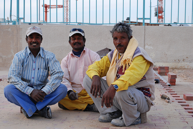 Builders at work in Qatar. From Boston's NPR News Station under CC License.