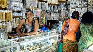 Neema, a Congolese refugee running a wholesale jewelry shop with her husband in Kampala (Photo by Flavie Halais, used with permission).